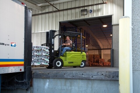 Clark forklift driving into truck
