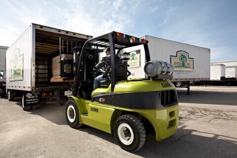 Clark forklift loading a truck