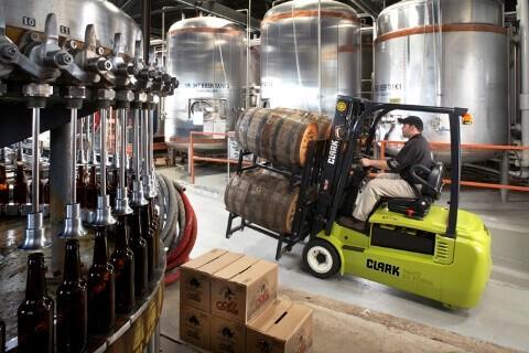 Clark forklift truck moving barrels