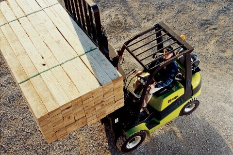 Clark forklift lifting pallet of wood